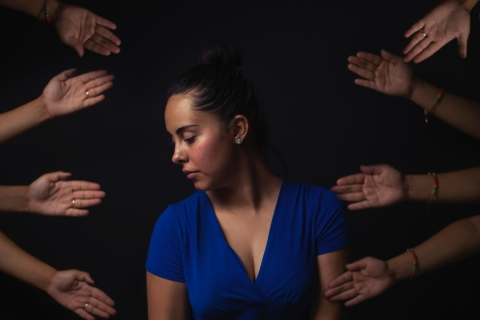 woman surrounded by helpful hands
