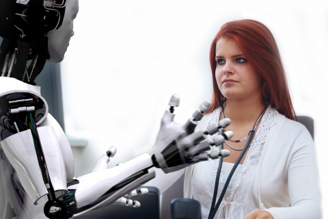 lady doctor conversing with robot