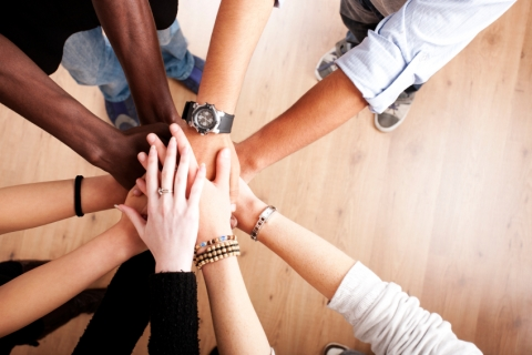 Teamwork_Coworkers_Hands_Huddle_iStock_000014186302Small