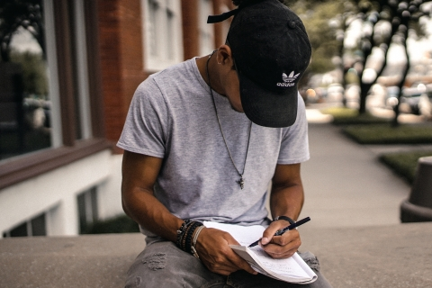 A person taking notes outside.