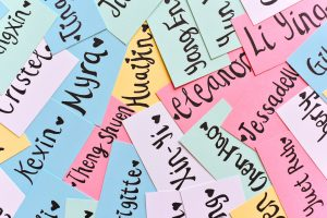 Names written on colorful paper.